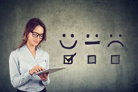 Customer experience concept. Happy business woman giving excellent rating for online satisfaction survey Stock Photo