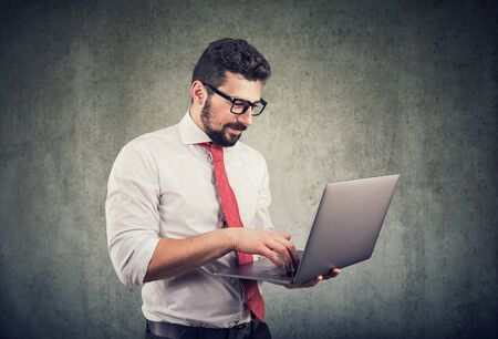 Happy businessman using laptop computer