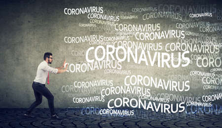 Young man gesturing stop to coronavirus infection