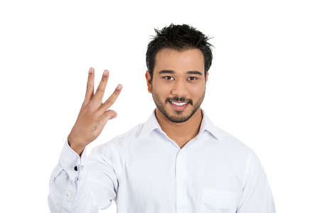 Closeup portrait of young handsome man giving a three fingers sign gesture with hand isolated on white background. Positive emotion facial expression feeling, signs and symbols