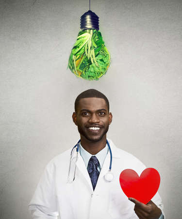 Portrait of a smiling doctor cardiologist advising on healthy diet for your heart