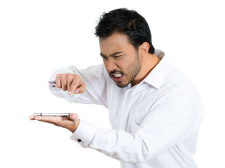 Closeup portrait of an angry young man shouting while on phone isolated on white background.
