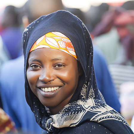 mozambique: Nampula, Mozambique - October 11, 2014: Young macua girl and first time voter attending a Frelimo rally for the Presidential and Parlamentary elections. Editorial