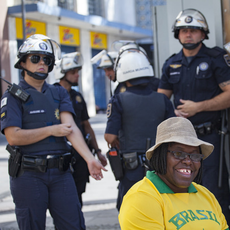 scandals: Afro-american woman posing with police officers during anti-government protests in Brazil, asking for Dilma Roussefs impeachment over corruption scandals, rising inflation and economy in crisis Editorial