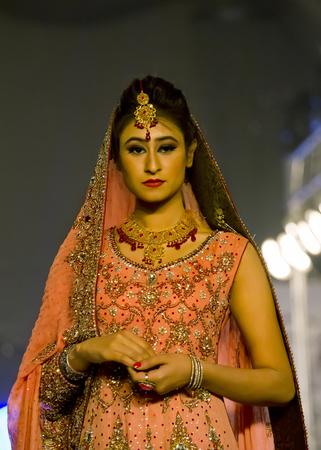 kameez: Lahore, Pakistan - April 4, 2013:  Models walk the runway finale during Lahore Fashion Week