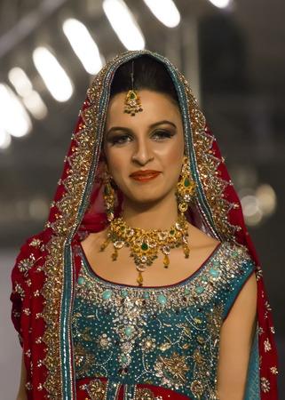 shalwar: Lahore, Pakistan - April 4, 2013:  Models walk the runway finale during Lahore Fashion Week