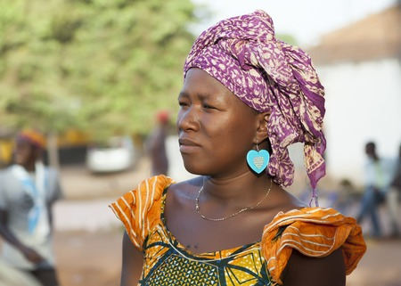 Gabu, Guinea-Bissau - March 28, 2014: Portrait of an unidentified african woman from fulani people wearing traditional clothes and scarf