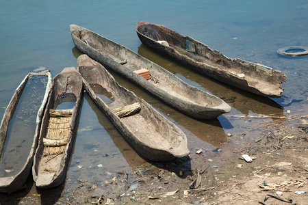 old wood canoes abandoned by the river