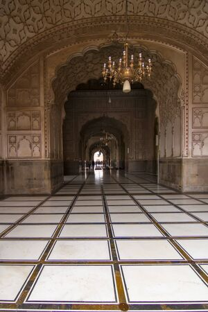 subcontinent: Lahore, Pakistan - April 27, 2013: Interior hall and archway in Badshahi Mosque, the main attraction and pilgimage site in Pakistan Editorial