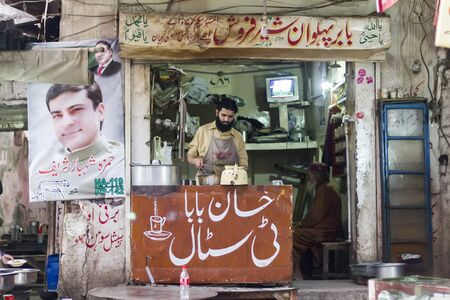 vendor: Street tea vendor at the bazar Editorial