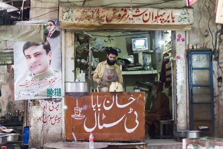 developing country: Street tea vendor at the bazar Editorial