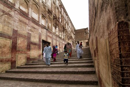 mughal empire: Lahore, Pakistan - April 27, 2013: Family visiting in Lahore fort, one of the main attractions in the city