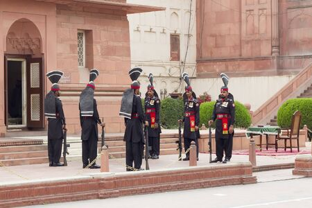 Lahore, Pakistan - April 27, 2013: Guards in traditional uniforms at the guard change ceremony  at Badshahi mosque