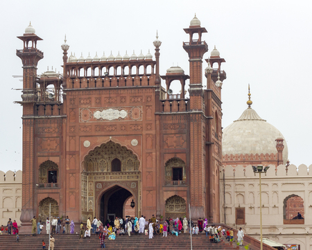 Lahore, Pakistan - April 27, 2013: Front entrance of historical Badshahi Mosque, the main attraction and pilgimage site in Pakistan