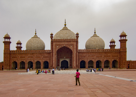 Lahore Pakistan - April 27, 2013: Badshahi Mosque Famous Landmark and Tourists Destination located in Lahore, Pakistan. It is also one of the biggest mosques in the world.