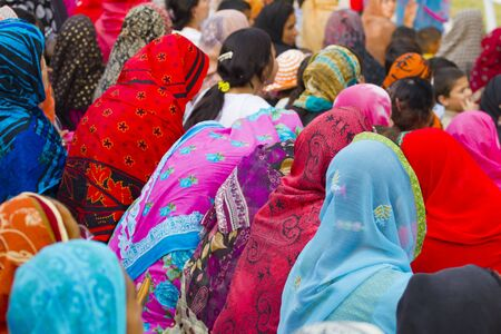 Lahore, Pakistan - May 5, 2013: Muslim women participating at a public event wearing colorful headscarves, duppattas and hijabs Redakční