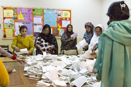 Lahore, Pakistan - May 11, 2013: Vote counting at a polling station for women in Lahore, Pakistan during the 2013 general elections.