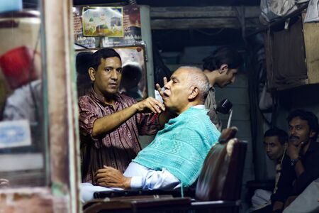 A traditional barber shop at anarkali bazaar in Lahore, Pakistan.