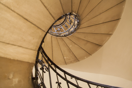 straight up view of a winding staircase