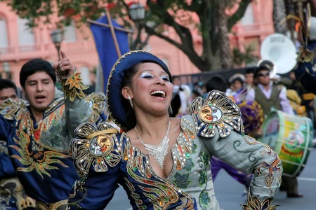 traditional clothes: Buenos Aires, Argentina - October 16, 2010: Bolivian immigrants in Buenos Aires celebrate the Virgen de Copacabana (virgin of copacabana), the patron saint of Bolivia in traditional clothes and dances Editorial