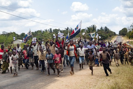 Nampula, Mozambique - October 4, 2014: Youth activists and children running to attend a political rally held Afonso Dhlakama, RENAMO leader and presidential candidate. Renamo and Dhlakama are very popular in northern Mozambique, especially in rural areas,