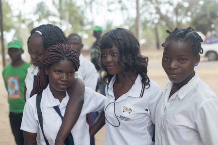 Nampula, Mozambique - October 4, 2014:  beautiful african girls in school uniform. Daily scenes from northern Mozambique