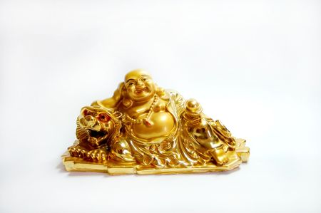 isolated golden Buddha sculpture