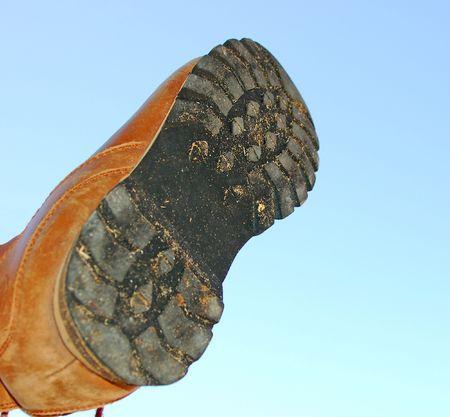 shoe sole over blue sky