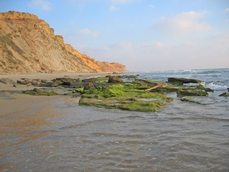 amazing stunning: beach landscape with a cliff
