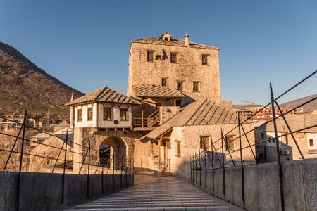 neretva: Tower on the west side of the Old bridge in the city of Mostar in the mourning sun