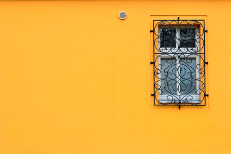 wood window: Single window on a orange wall with room for copy or text.