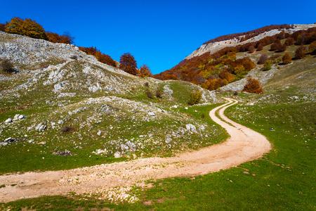 macadam: Mountain macadam road during bright summer day