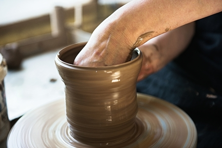 A lace maker and ceramicist create artwork. Hands top view Banco de Imagens