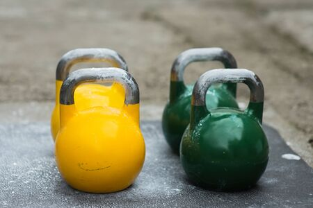 used kettlebell outside on the floor ready for strength and conditioning workout and training