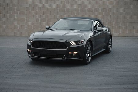 Kaunas, Lithuania - MAY 4, 2019: Gray american muscle car Ford Mustang GT with modifications standing alnone at city malls parking.