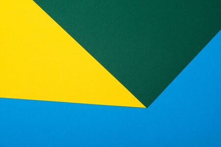 stationery background of folded blue green and yellow sheets of paper 版權商用圖片