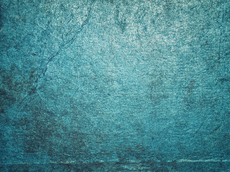 of irradiated: Cracking and peeling blue paint on a wall. Vintage wood background with peeling paint. Old board with Irradiated paint
