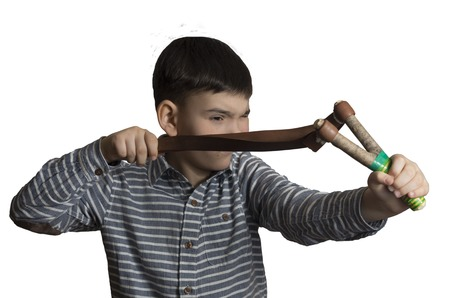boy with a slingshot in his hands