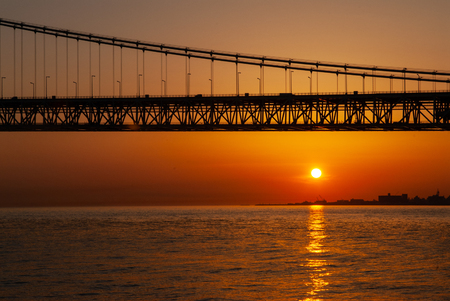 Large suspension bridge over the Strait and sunset