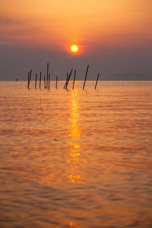 Fishing gear and sunrise at Lake Biwa