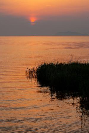The rising sun from the lake Biwa Stock Photo
