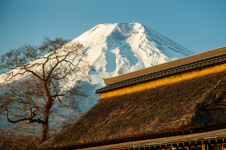 Mount Fuji with the roof and snow of a Japanese house Stock Photo