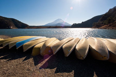 Rowed boats at the lake where Mt. Fuji can be seen Stock Photo