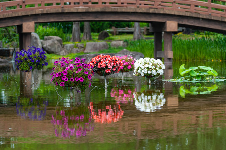 Bridge and colorful pots over the pond Imagens - 124936949