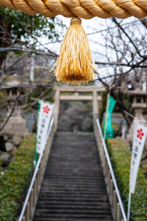 Shinto shrine ornaments and wet stairs