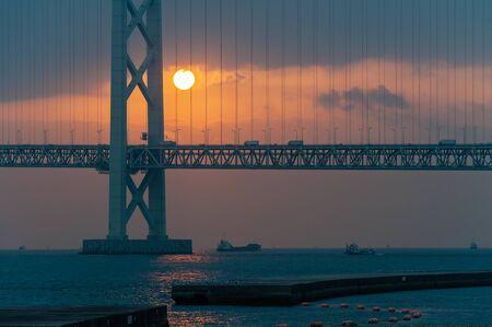 Suspension Bridge over the Seto Inland Sea and Sunset Imagens