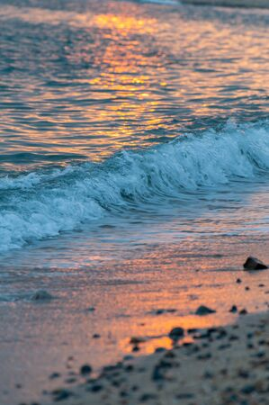 The sea and waves dyed red at sunset