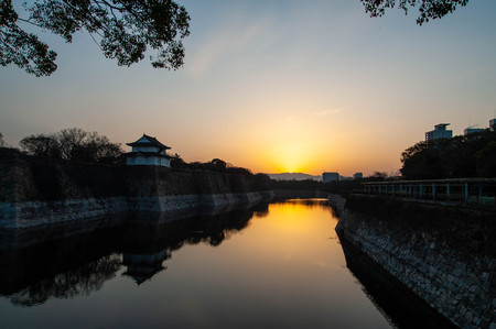 Hori and Ishigaki of Osaka Castle at a beautiful sunrise 報道画像