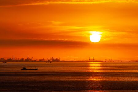Bright red sunrise and reflection on the sea of the sun Stok Fotoğraf