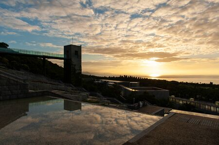 Beautiful cloud sunrise, buildings and water pools Stok Fotoğraf